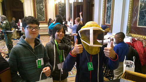 Local middle-school students participating in a demonstration on pollinators during the White House Day at the Lab.